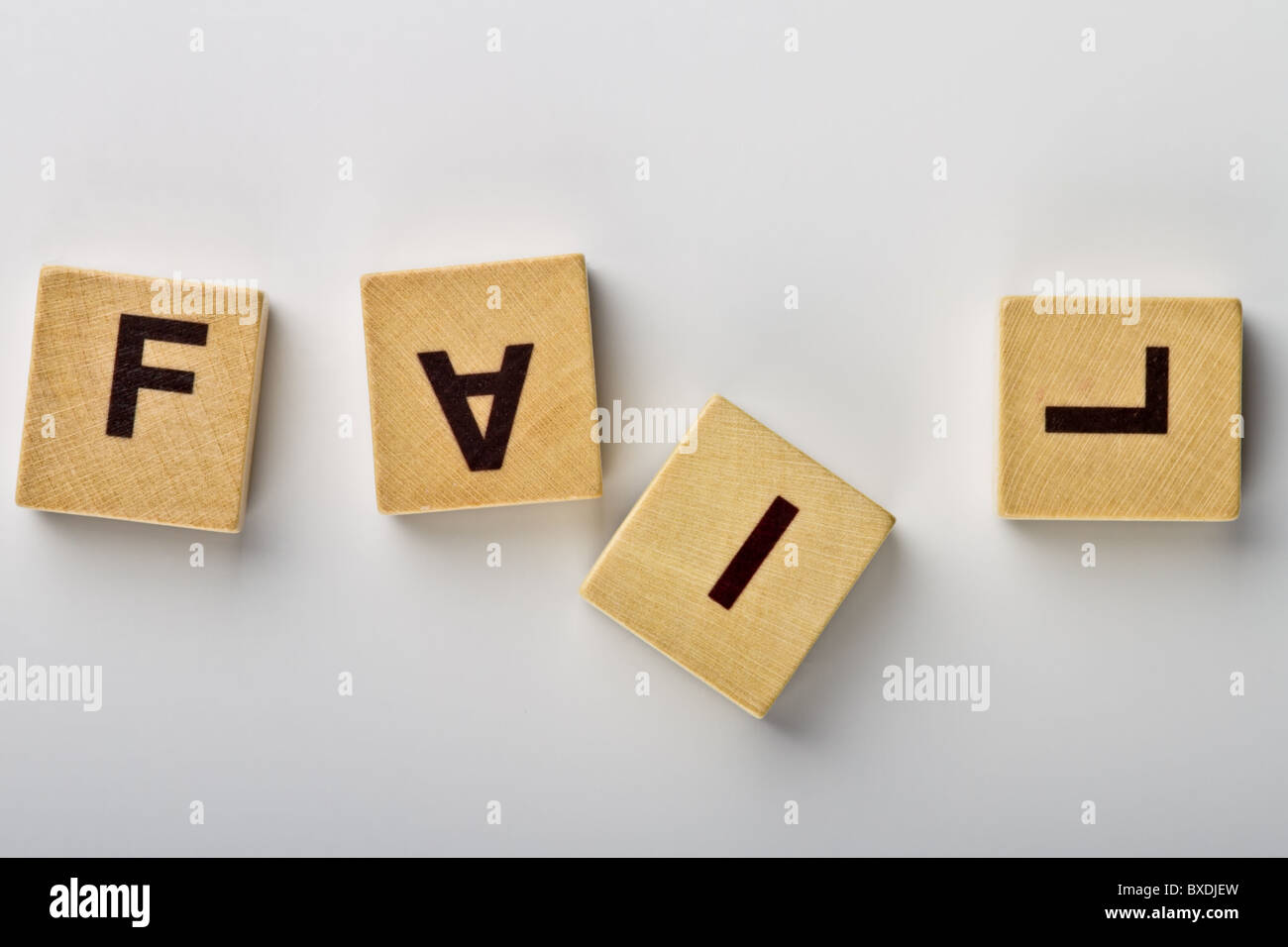 Wood magnets spelling 'FAIL' with leaning letters - Stock Image