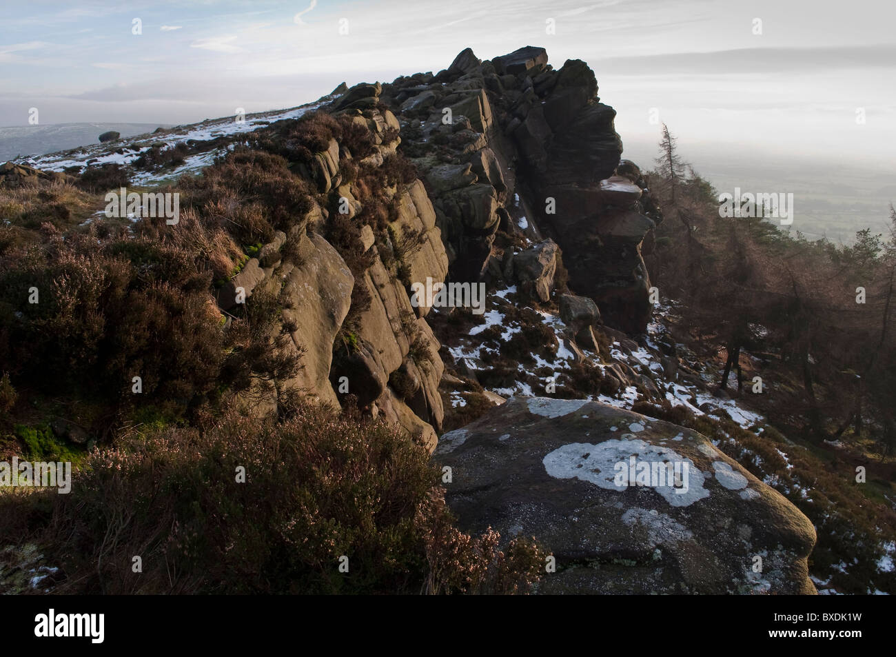 The gritstone escarpment of The Roaches in winter, Staffordshire Moorlands - Stock Image