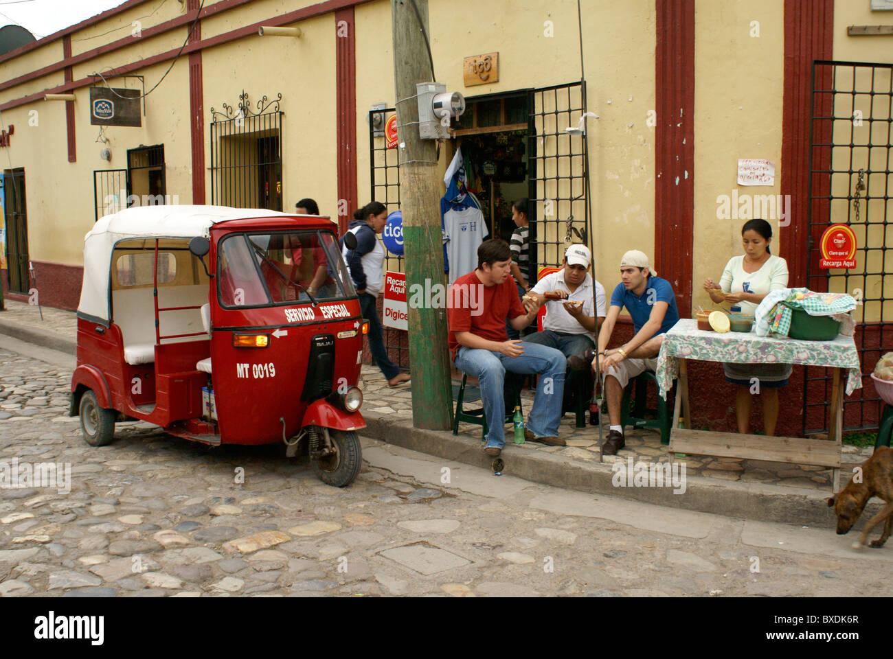 Busy street corner in the town of Copan Ruinas, Honduras - Stock Image