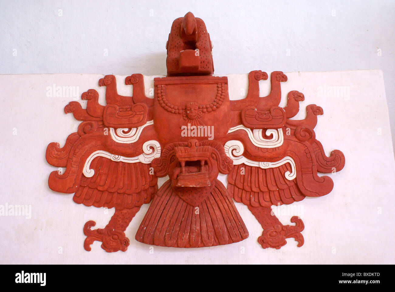 Replica of a red stucco macaw sculpture from Ballcourt I at the Mayan ruins of Copan, Copan Sculpture Museum Honduras - Stock Image