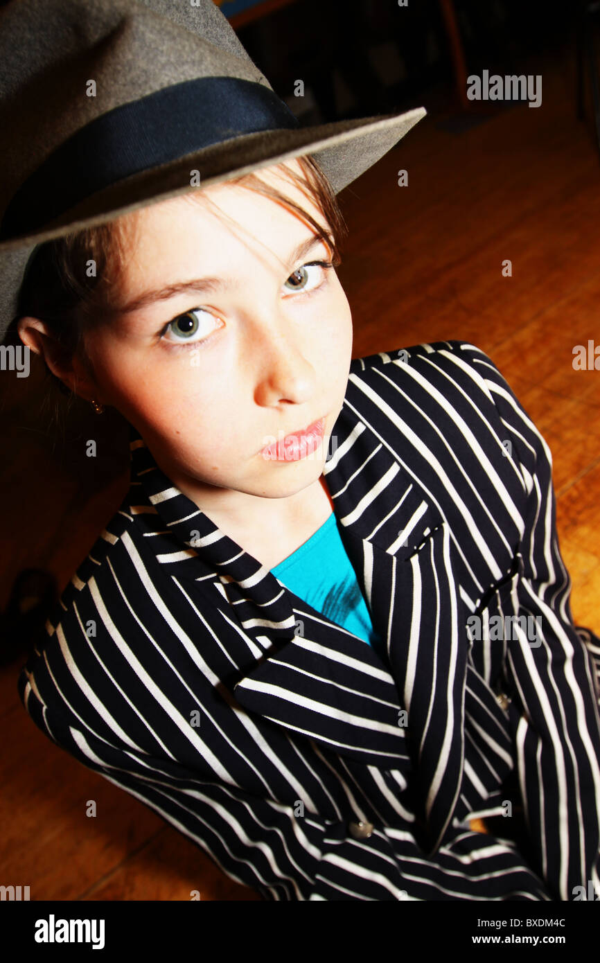 young girl in gangster suit outfit - Stock Image
