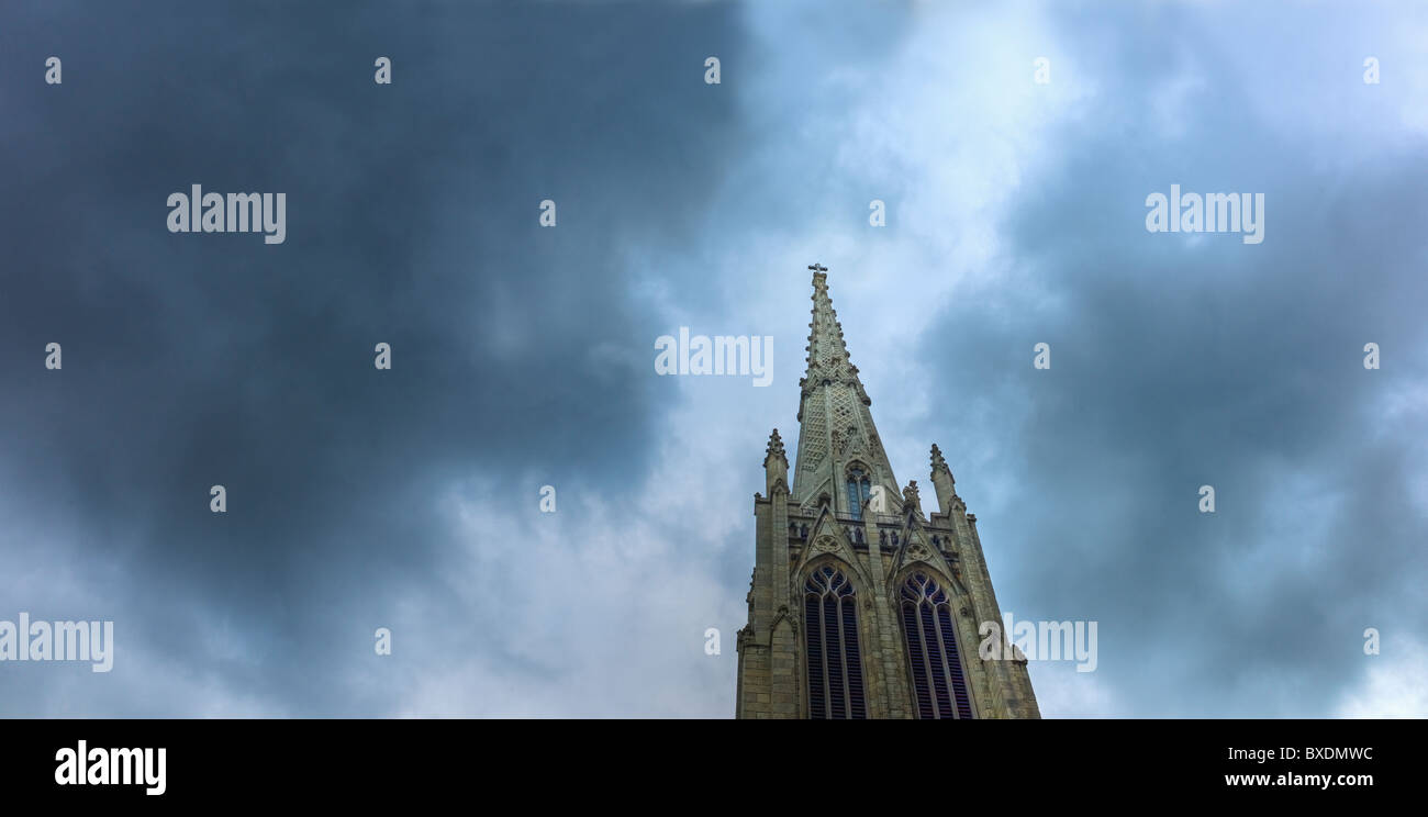 Dark clouds over steeple on Grace Church Stock Photo