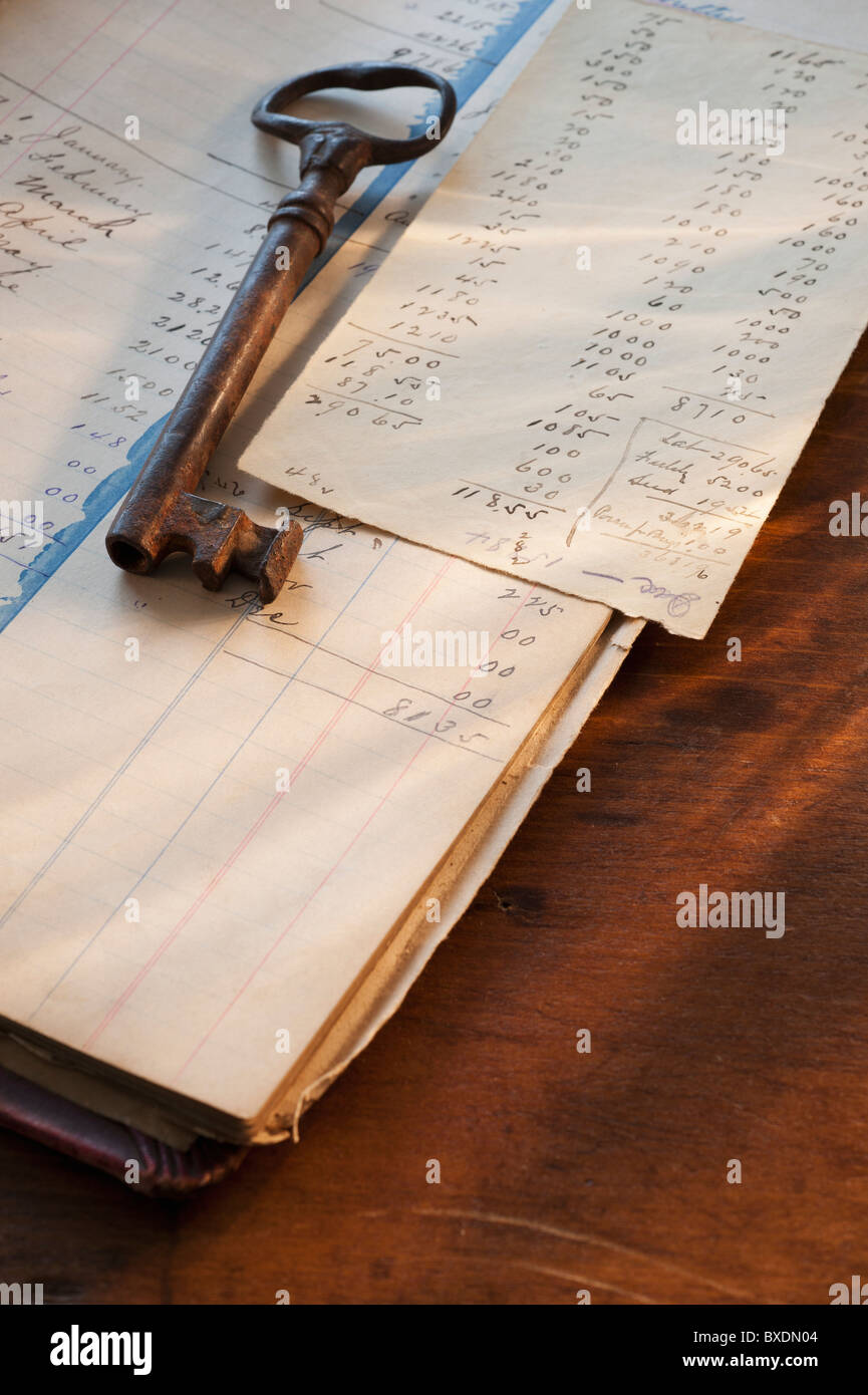 Antique key on top of ledger - Stock Image