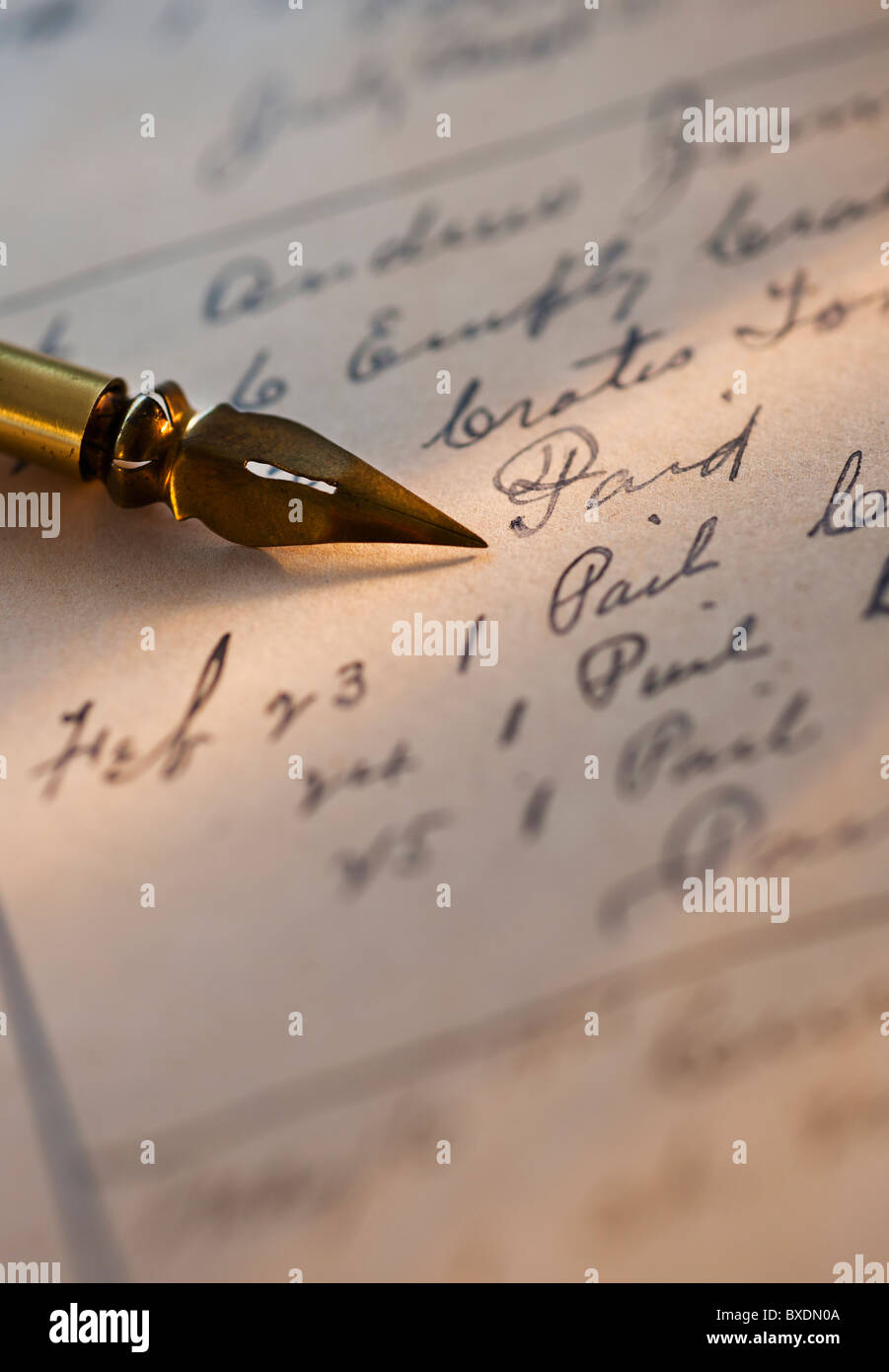 Antique pen on top of list - Stock Image