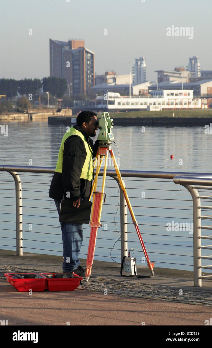 Surveyor using theodolite East London UK 2008 - Stock Image