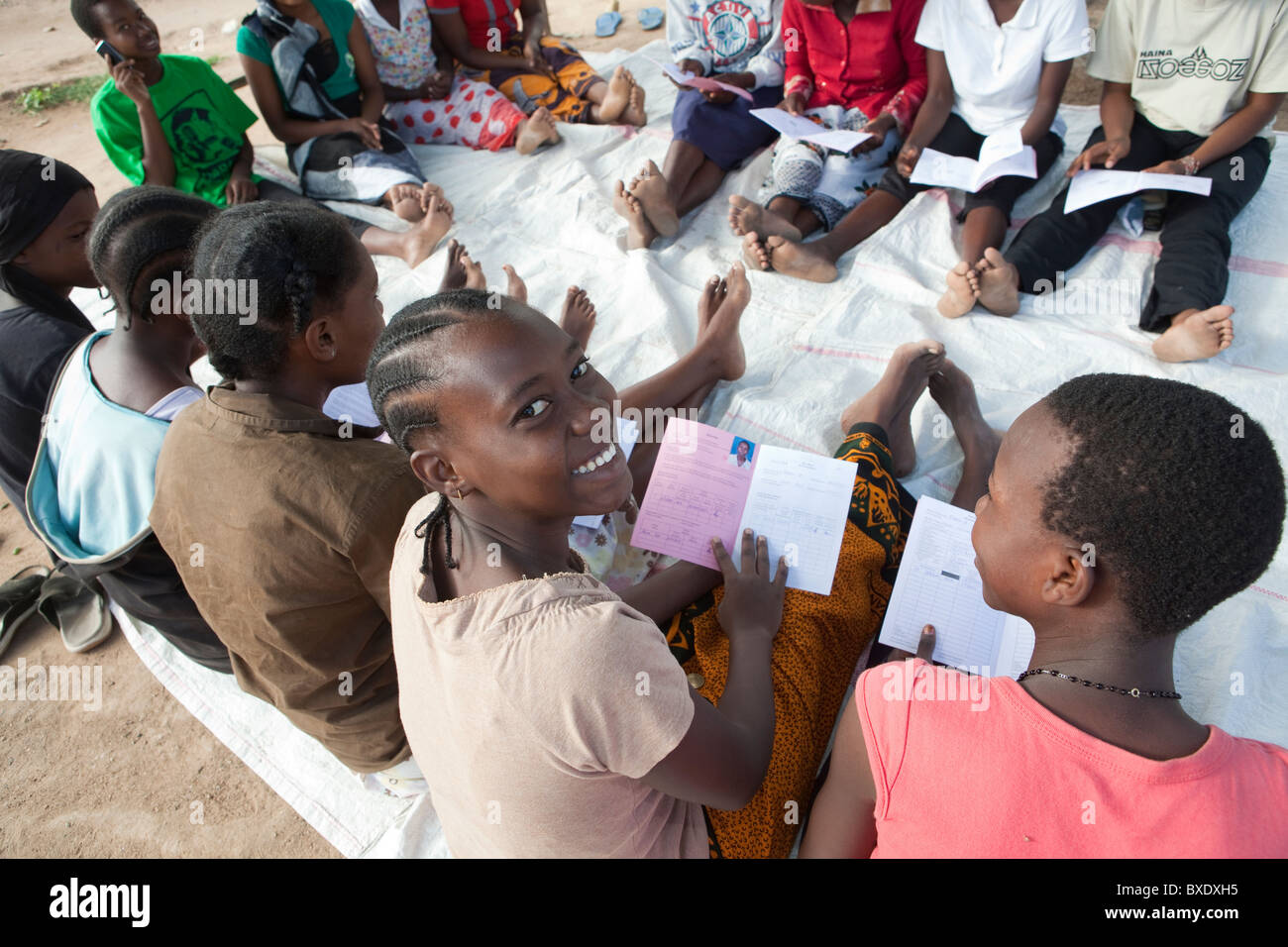 Teenage girls attend a VSLA community meeting in Dodoma, Tanzania, East Africa. - Stock Image