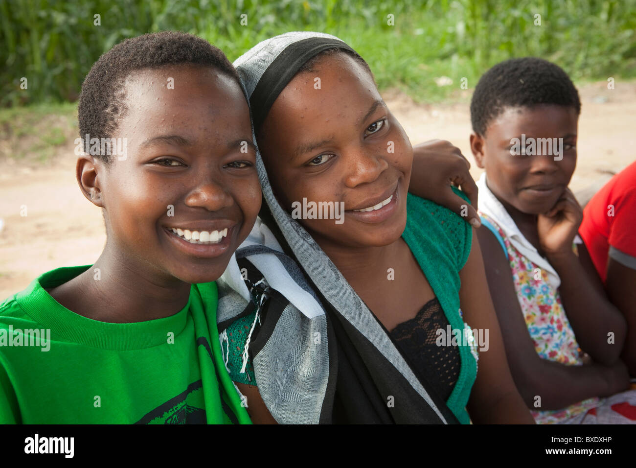 Teenage girls attend a community meeting in Dodoma, Tanzania, East Africa. - Stock Image