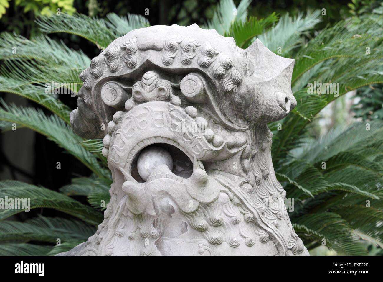 Lion Statue In Chinese Garden