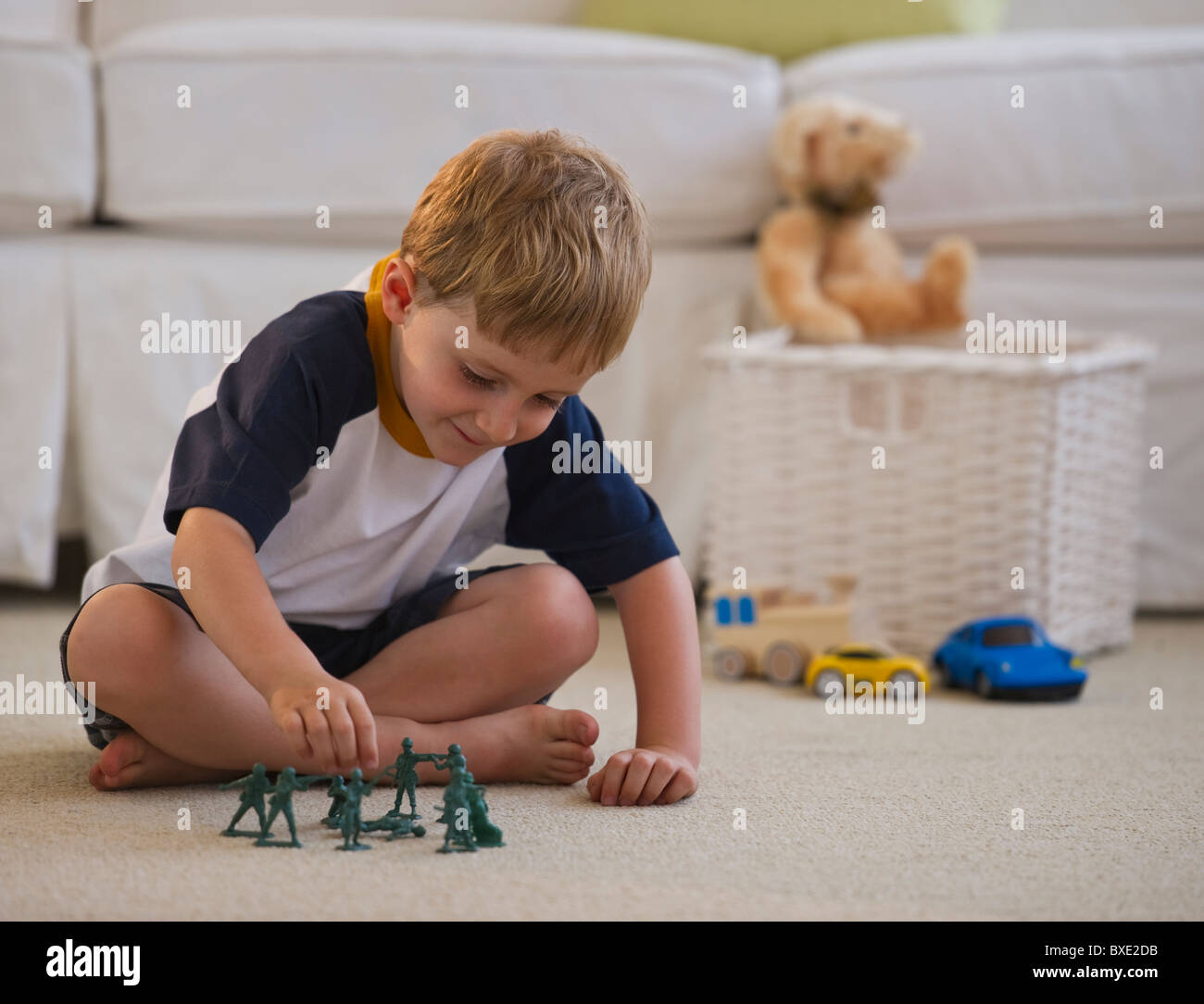 Young Boy Playing With Toy Soldiers Stock Photo 33500695