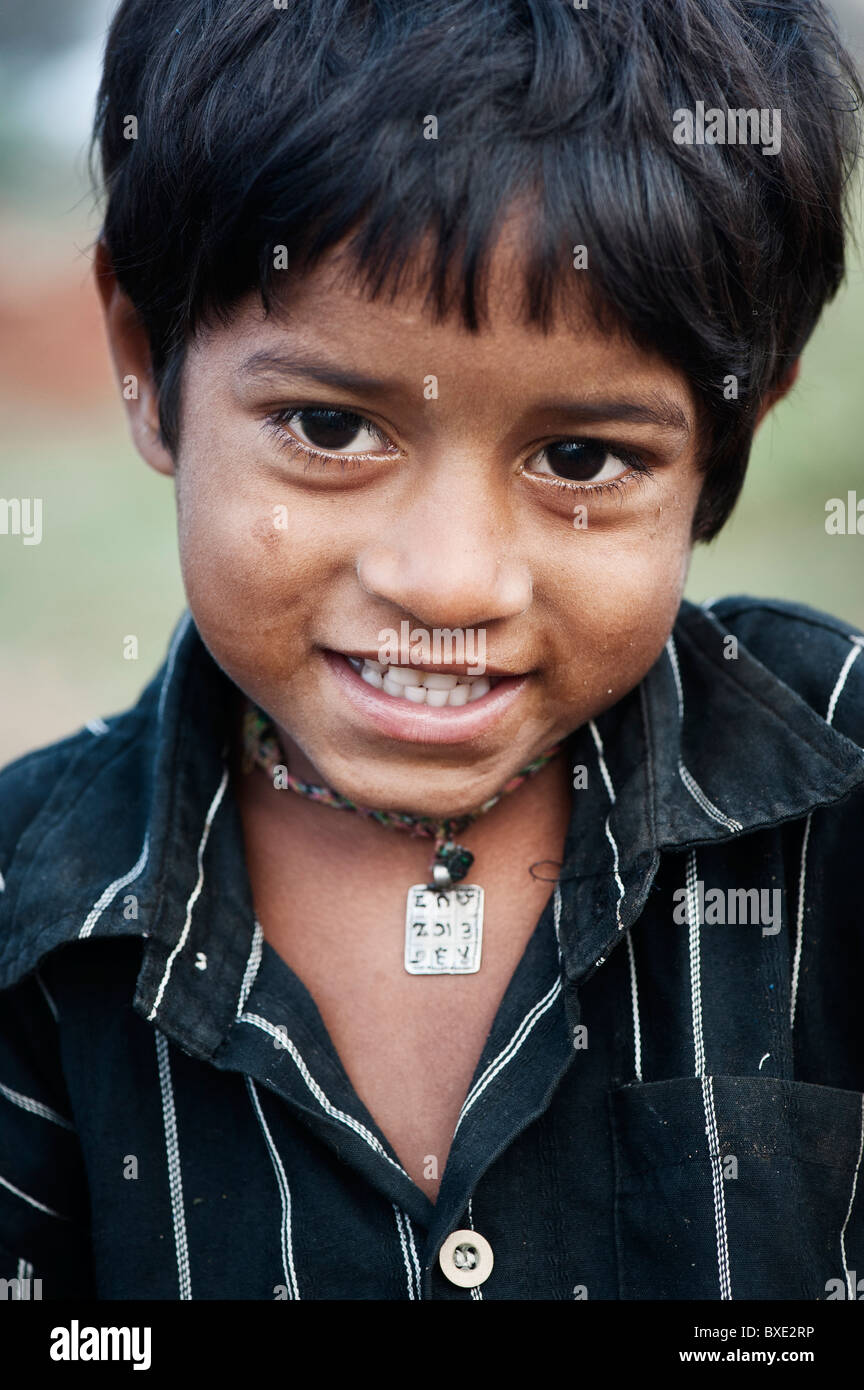 Young poor lower caste Indian street boy smiling. Andhra Pradesh, India - Stock Image
