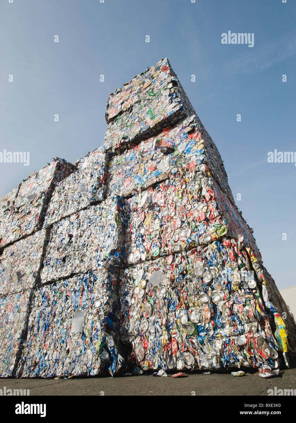 Stacks of crushed aluminum cans - Stock Image