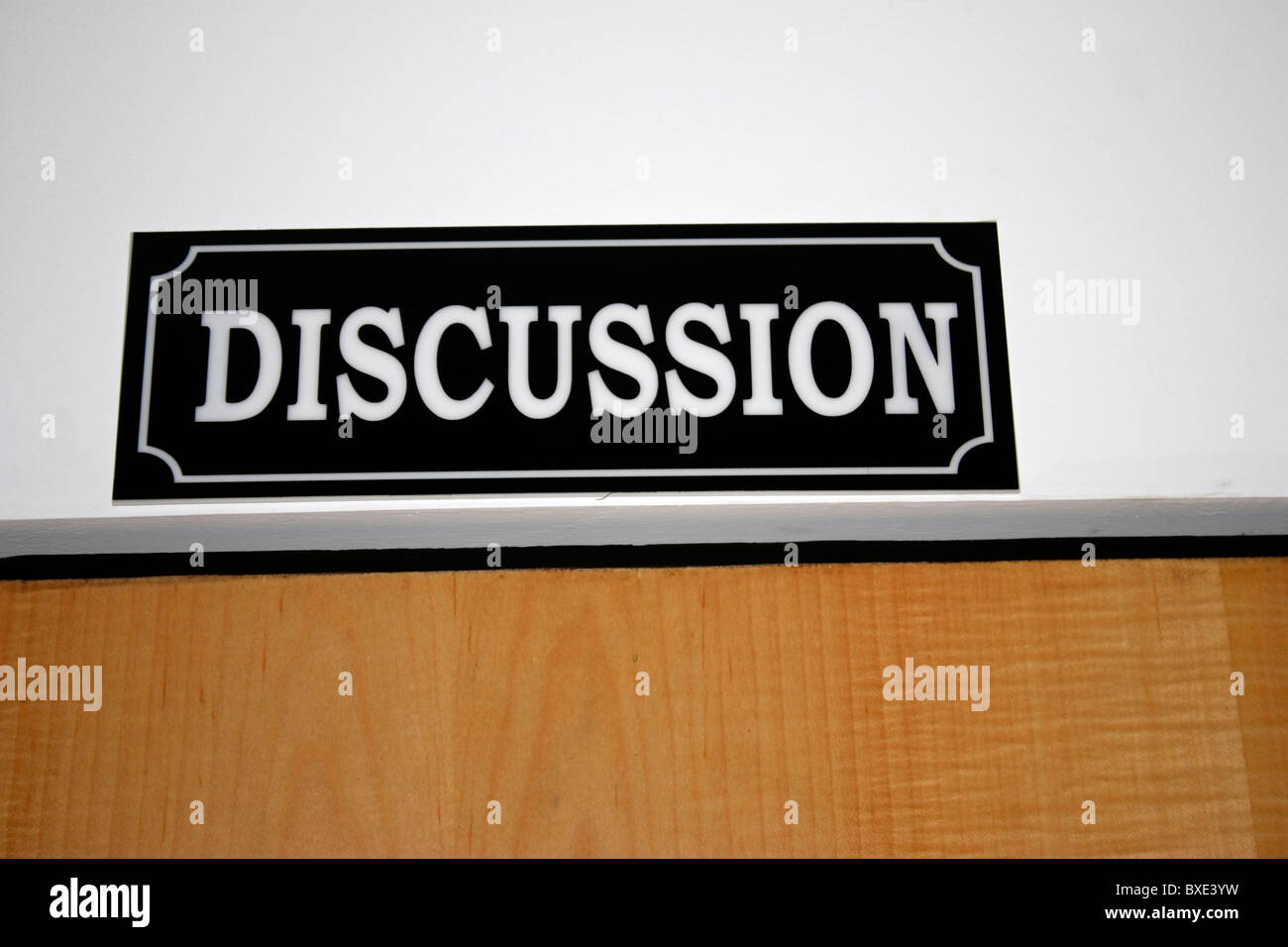 A board displayed in front of a discussion room - Stock Image