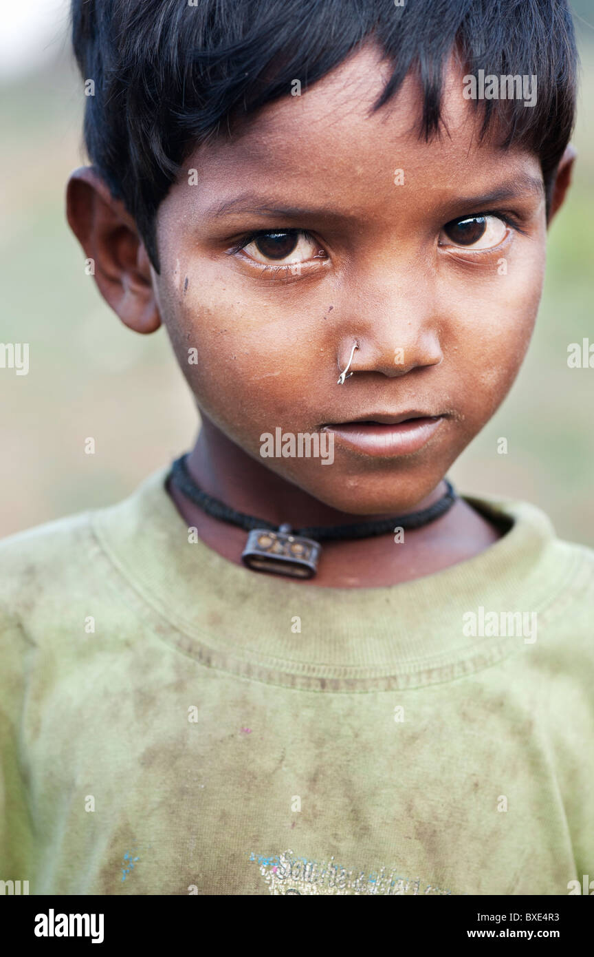 Young poor lower caste Indian street boy with a pierced nose. Andhra Pradesh, India Stock Photo