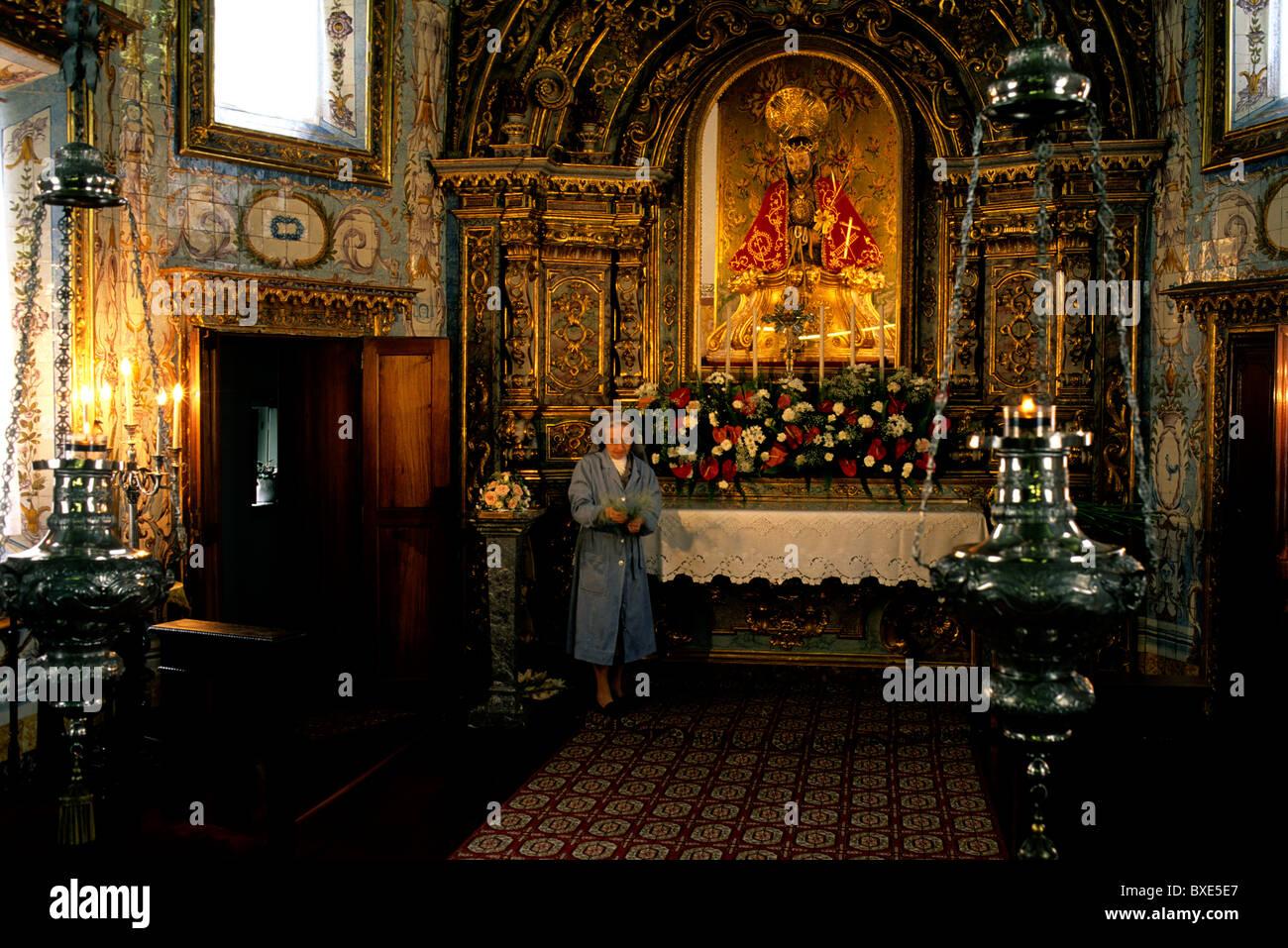 The gilded interior of the Chapel of Nossa Senhora da Esperança in Ponta Delgada on São Miguel island - Stock Image