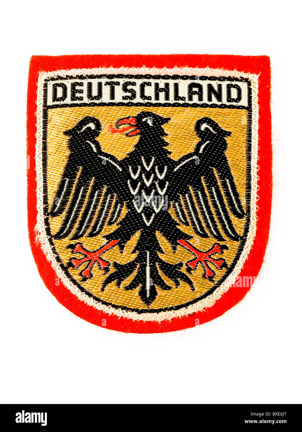 Embroidered cloth badge, or patch, depicting Germany with the . Eagle Shield shape. From about 1964. - Stock Image