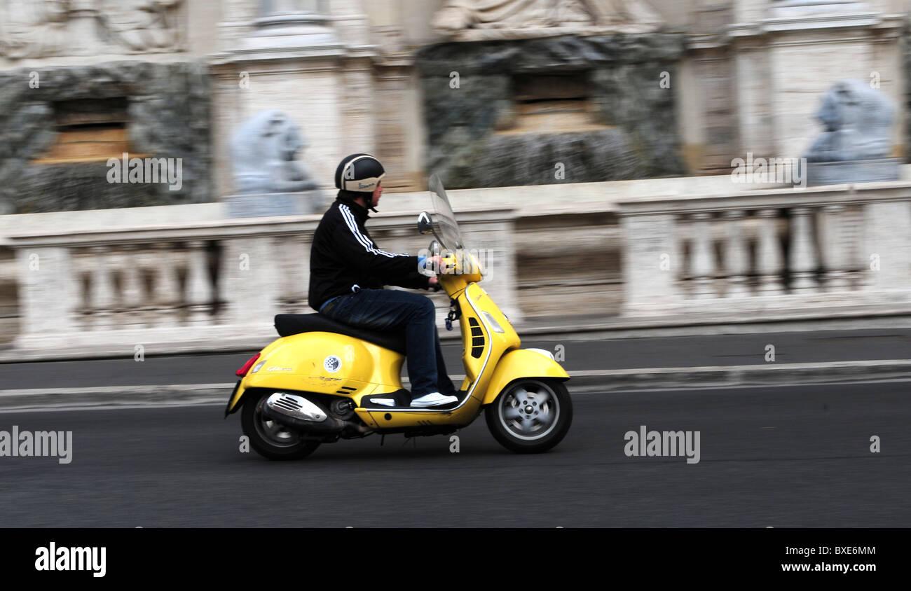 Motorbike rider in front of Fontana dell'Acqua Felice Roma Italy - Stock Image
