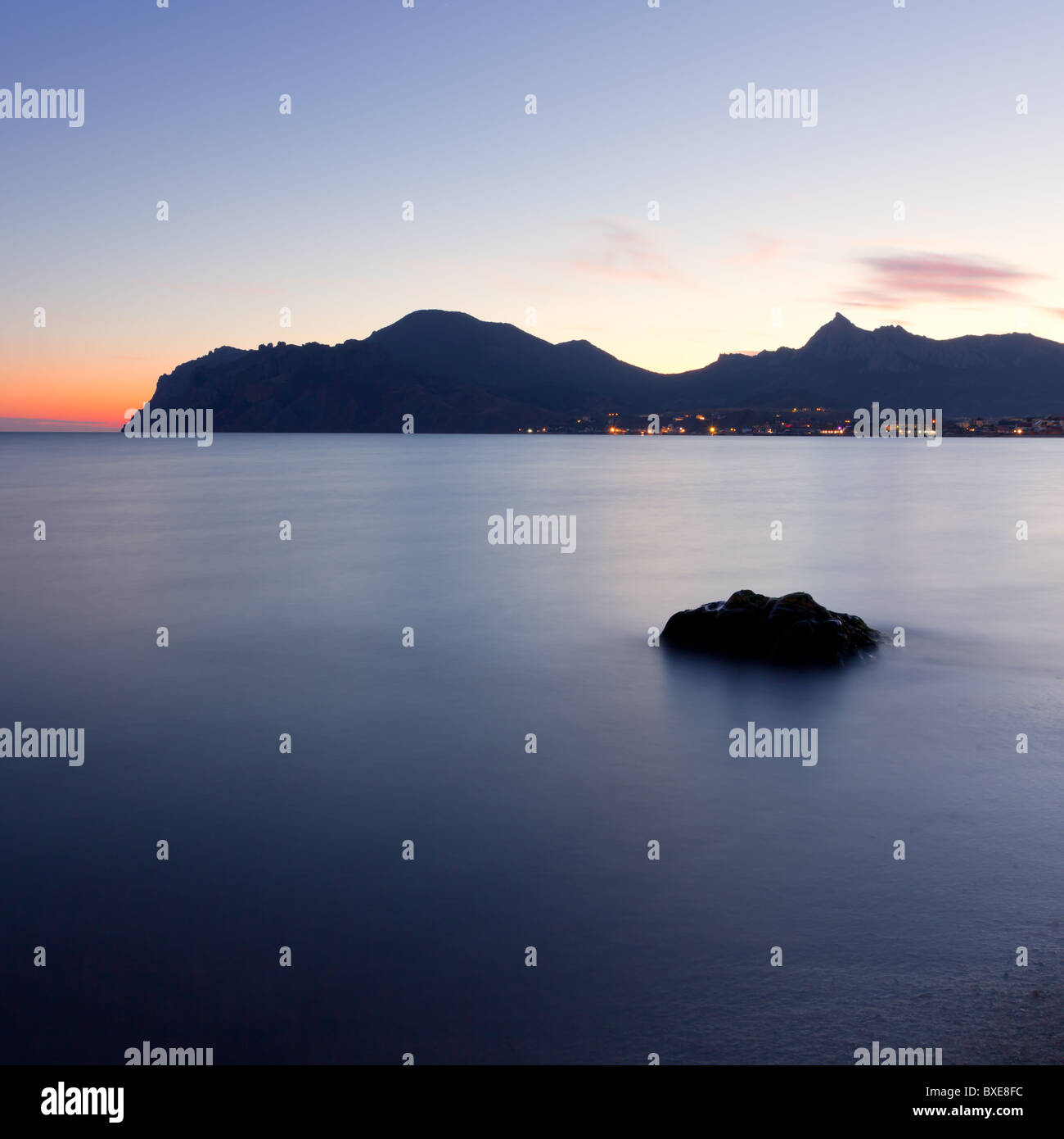 twilight time on the rocky coast of sea. Crimea, Ukraine - Stock Image