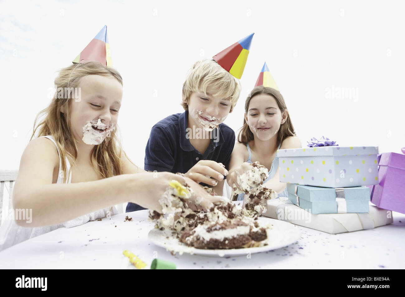 Outstanding Children Eating Birthday Cake With Their Hands Stock Photo Funny Birthday Cards Online Hendilapandamsfinfo