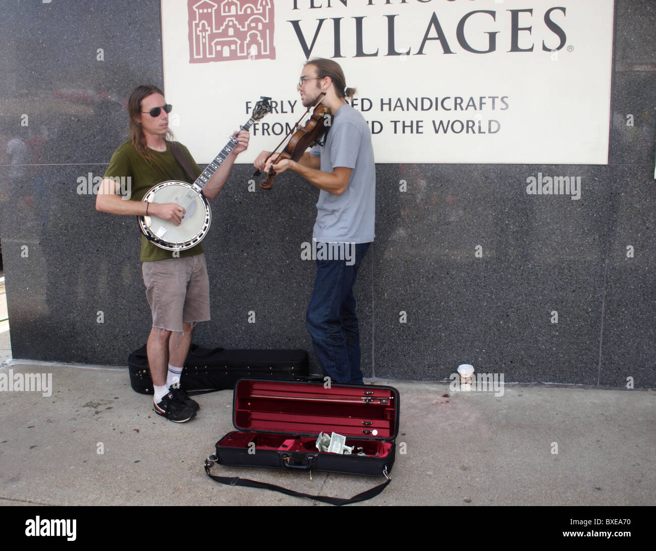 Two young street musicians performing in Richmond, Virginia - Stock Image