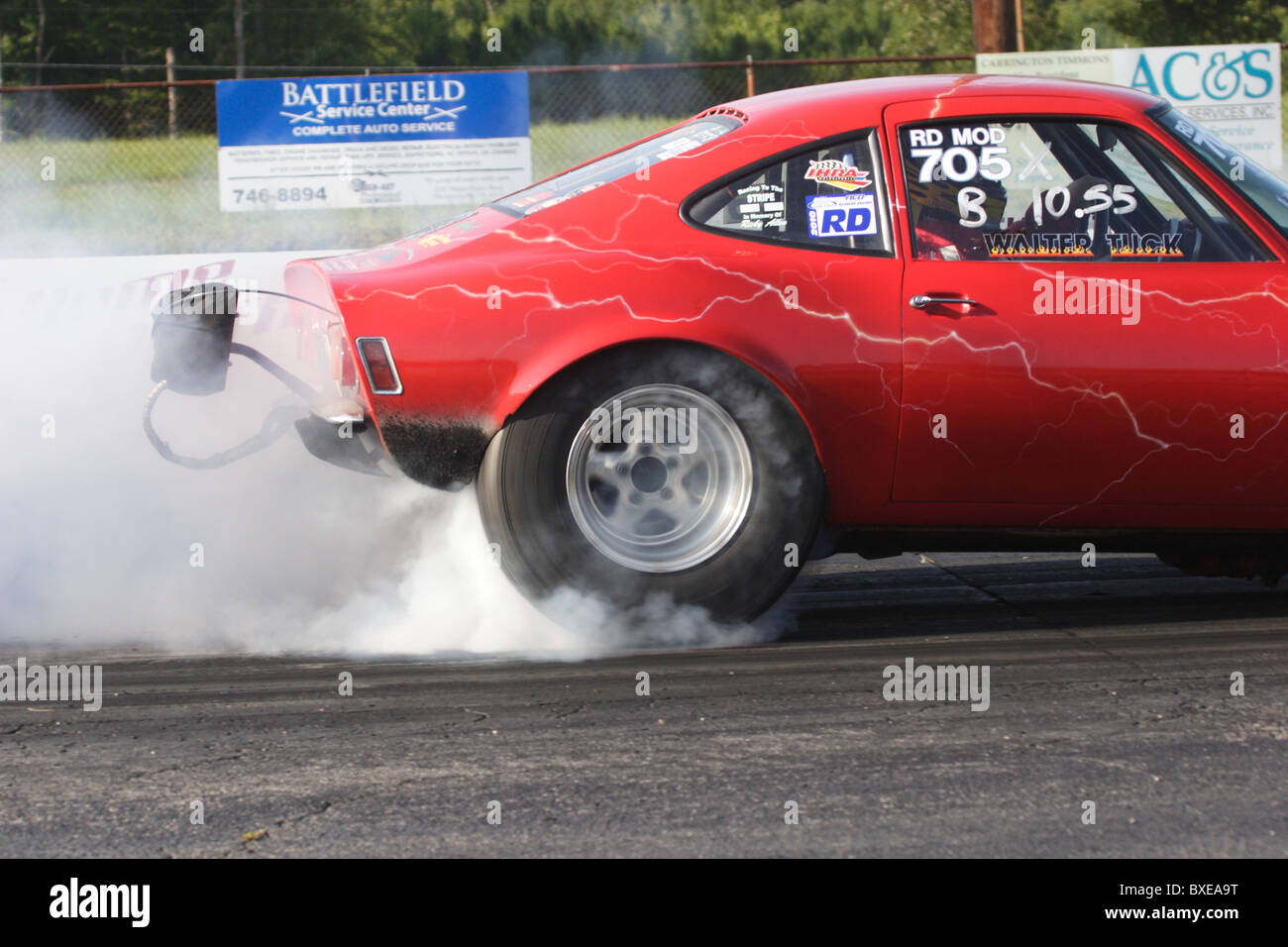 Racing car spinning wheels before race at Richmond Dragway in Sandston, Virginia. Stock Photo