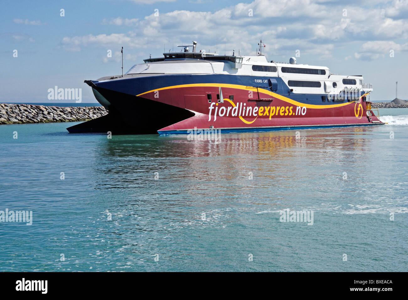 Fjordline high speed car and passenger ferry Fjord Cat leaving Hirtshals harbour in Jutland Denmark en route to - Stock Image