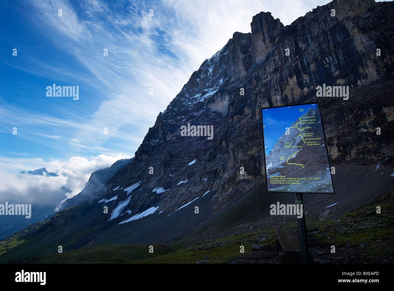 View of the Eiger North Face and sign showing the route of the first ascent, Bernese Oberland, Switzerland - Stock Image