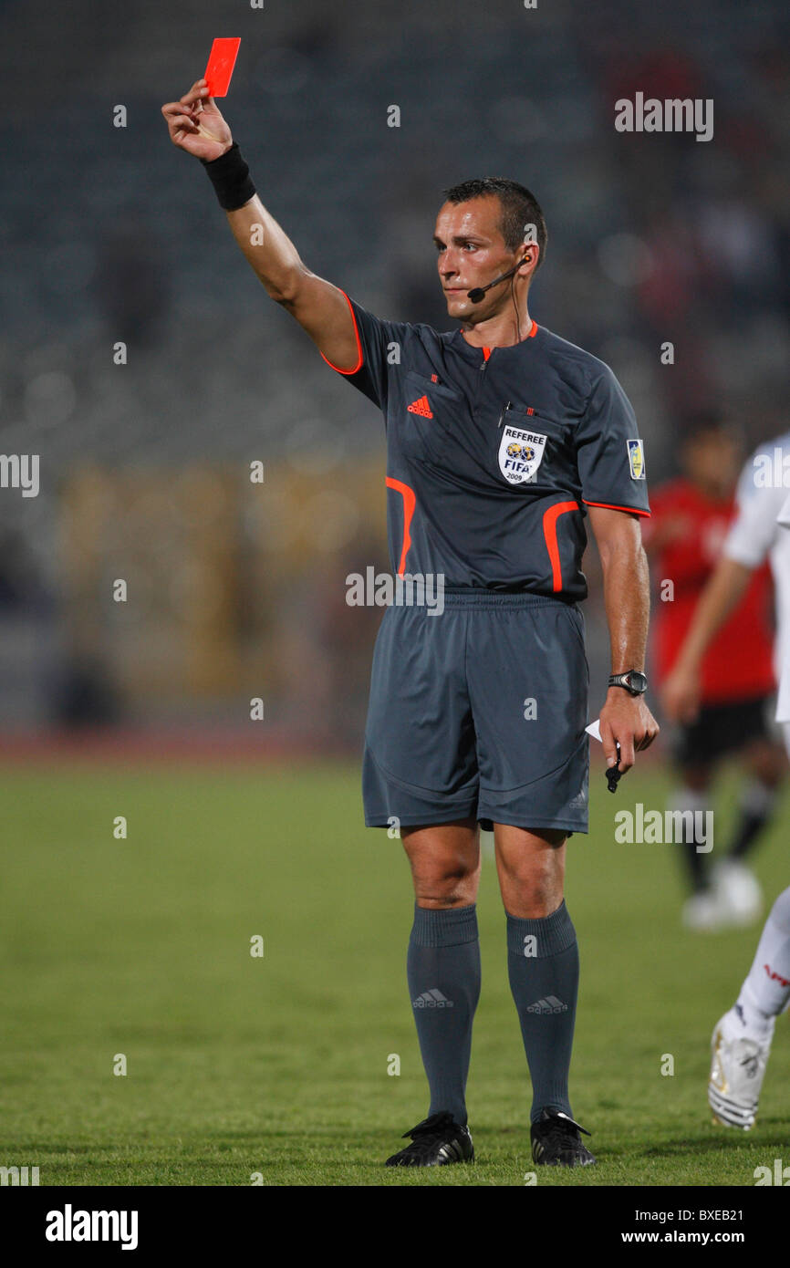 Referee Ivan Bebek displays a red card and ejects Paraguay's Ronald Huth from a 2009 U-20 World Cup soccer match - Stock Image