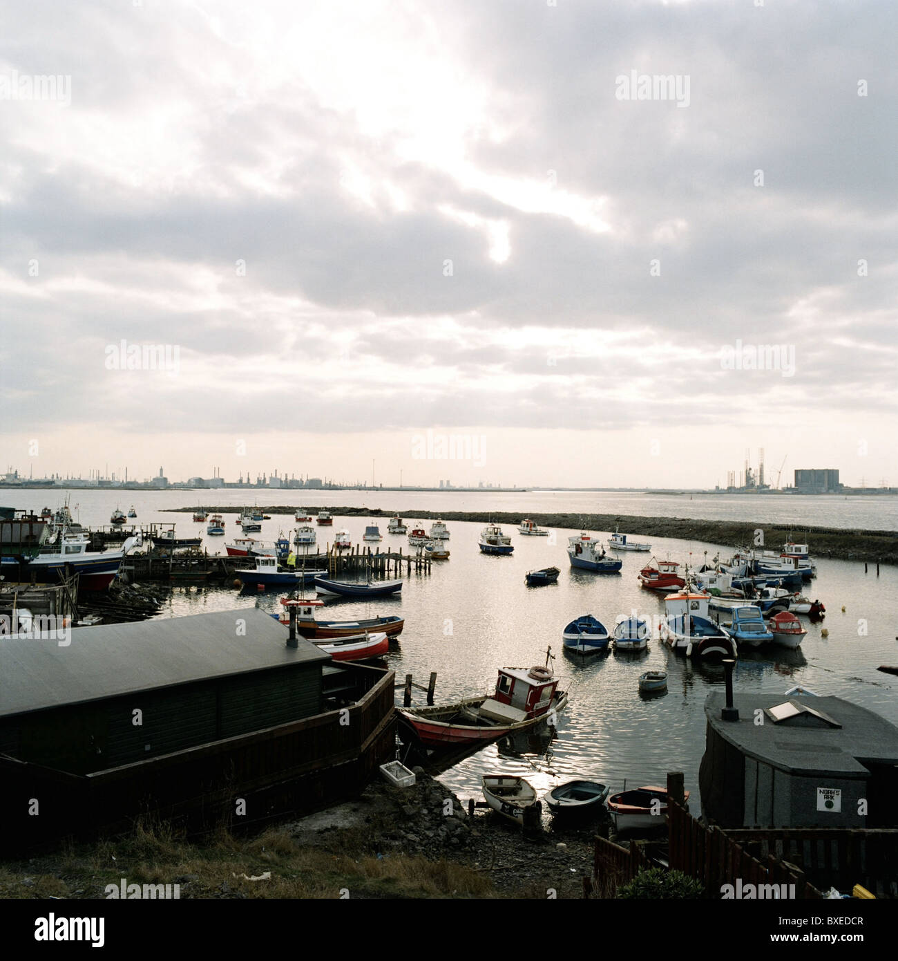 Fishing boats docked at high tide in Paddy's Hole harbour, near Redcar, Cleveland. - Stock Image