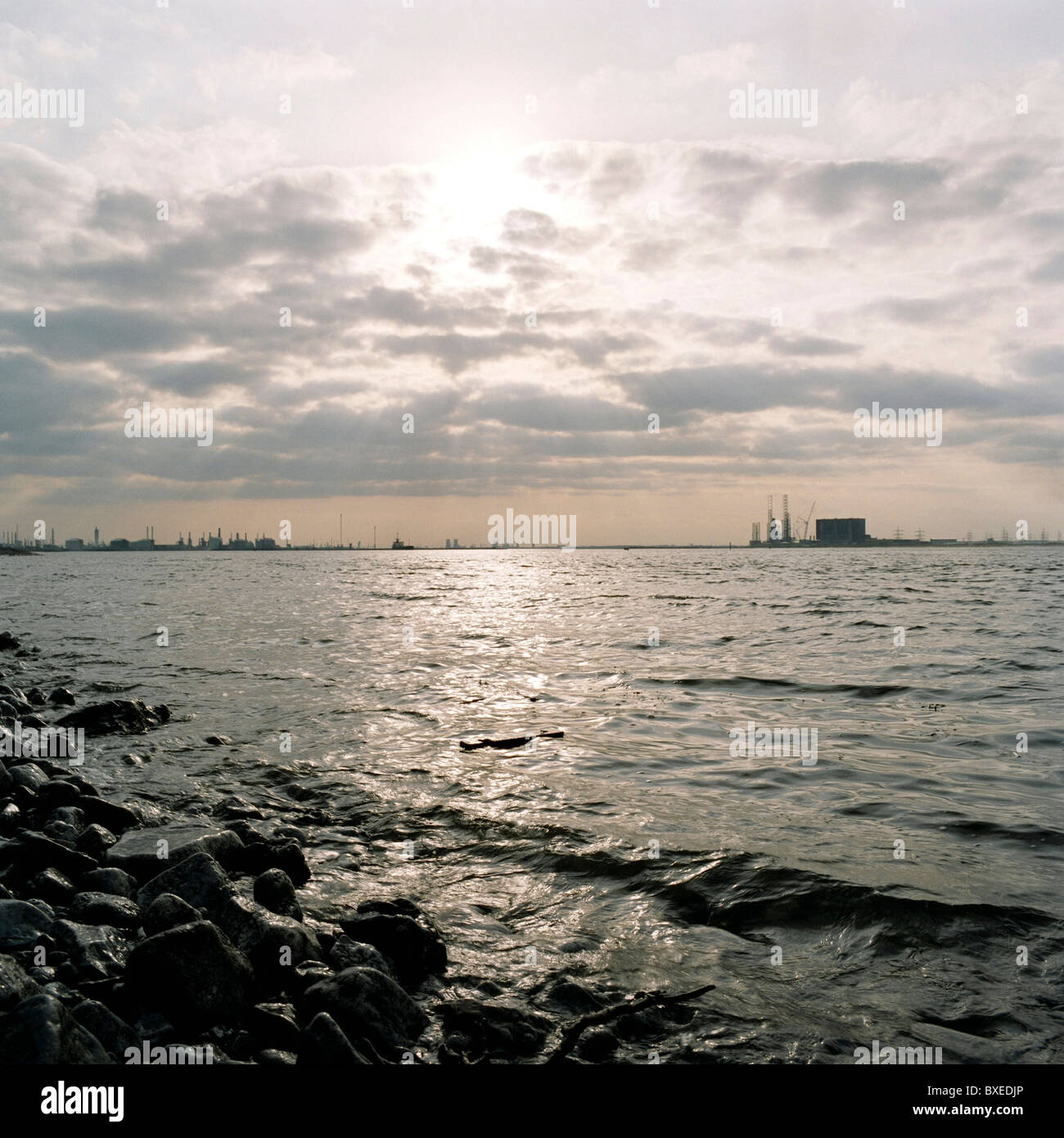 View across River Tees estuary  from South Gare to Oil Refinery Processing Plants in and Hartlepool Nuclear Power - Stock Image