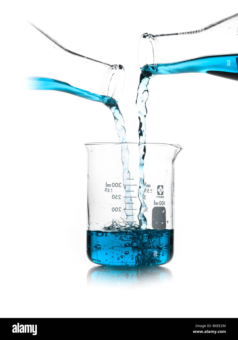 Blue Liquid Being Poured Into Measuring Cup Stock Photo