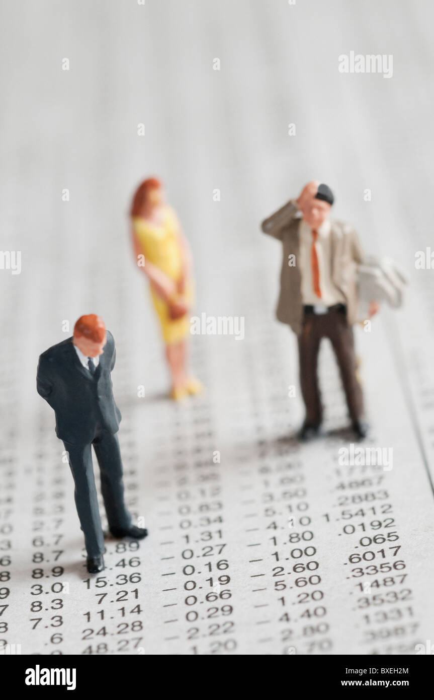 Figurines of people standing on stock chart - Stock Image