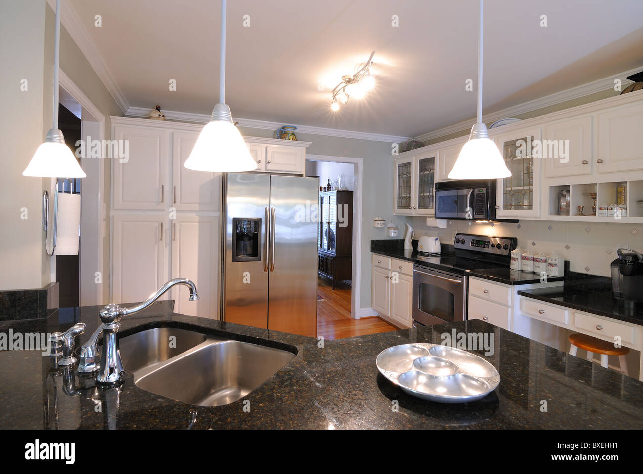 Modern Kitchen Appliances and lighting fixtures - Stock Image