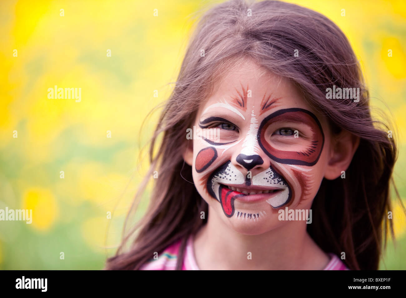 happy face painted girl - Stock Image
