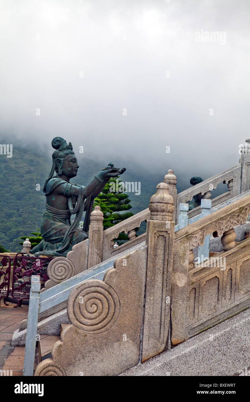 Hong Kong, Lantau island seated bronze statue Buddha, offering to the buddah - Stock Image