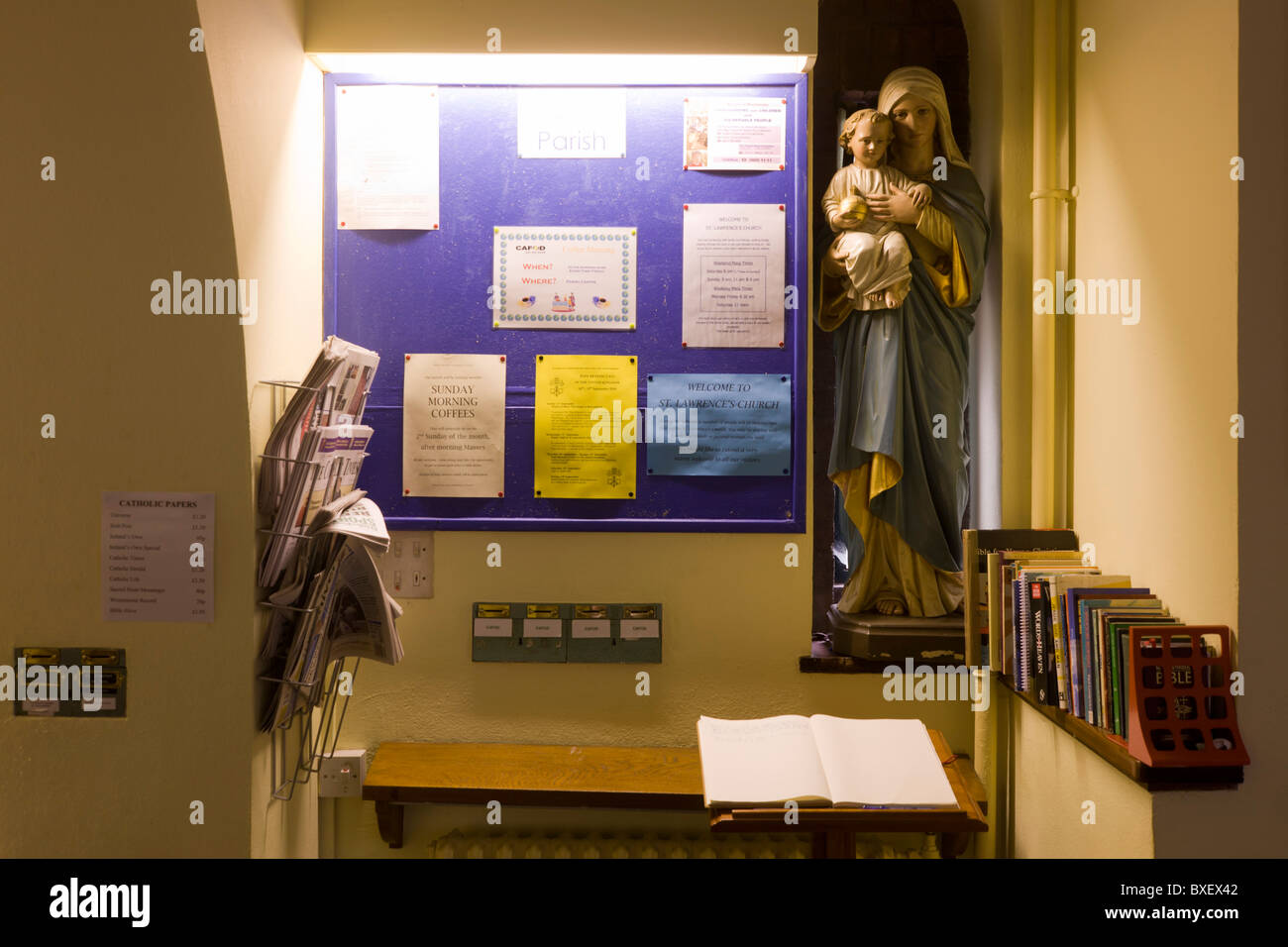 Noticeboard with Mary and Jesus figures at St. Lawrence's Catholic church in Feltham, London. - Stock Image