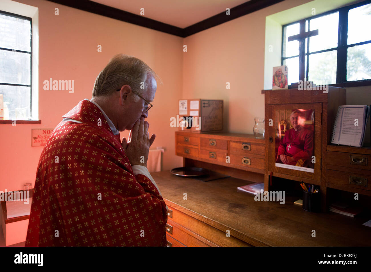 Priest says brief prayer in backroom sacristy vestry before mass priest says brief prayer in backroom sacristy vestry before mass at st lawrences catholic church in feltham london altavistaventures Gallery