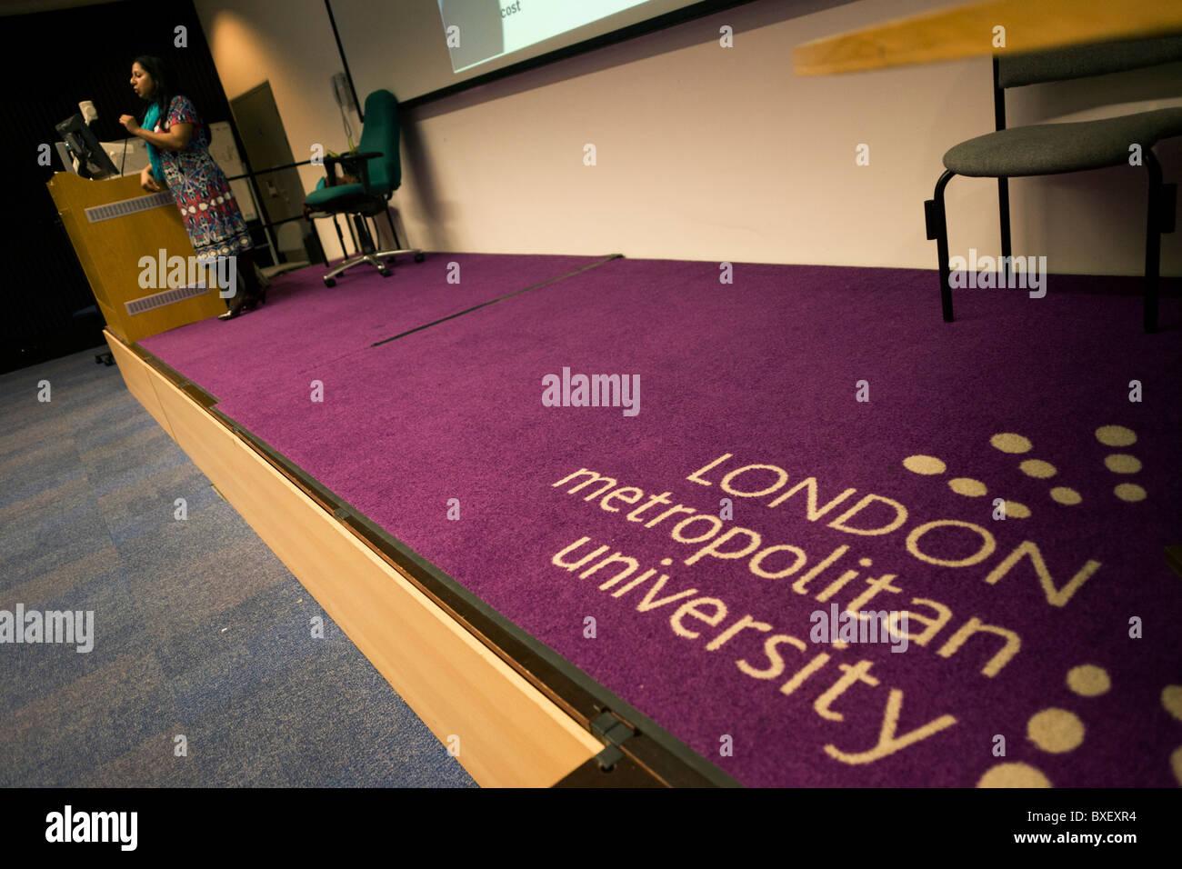 Purple corporate logo on lecture theatre carpet of London Metropolitan University's Holloway Road. - Stock Image