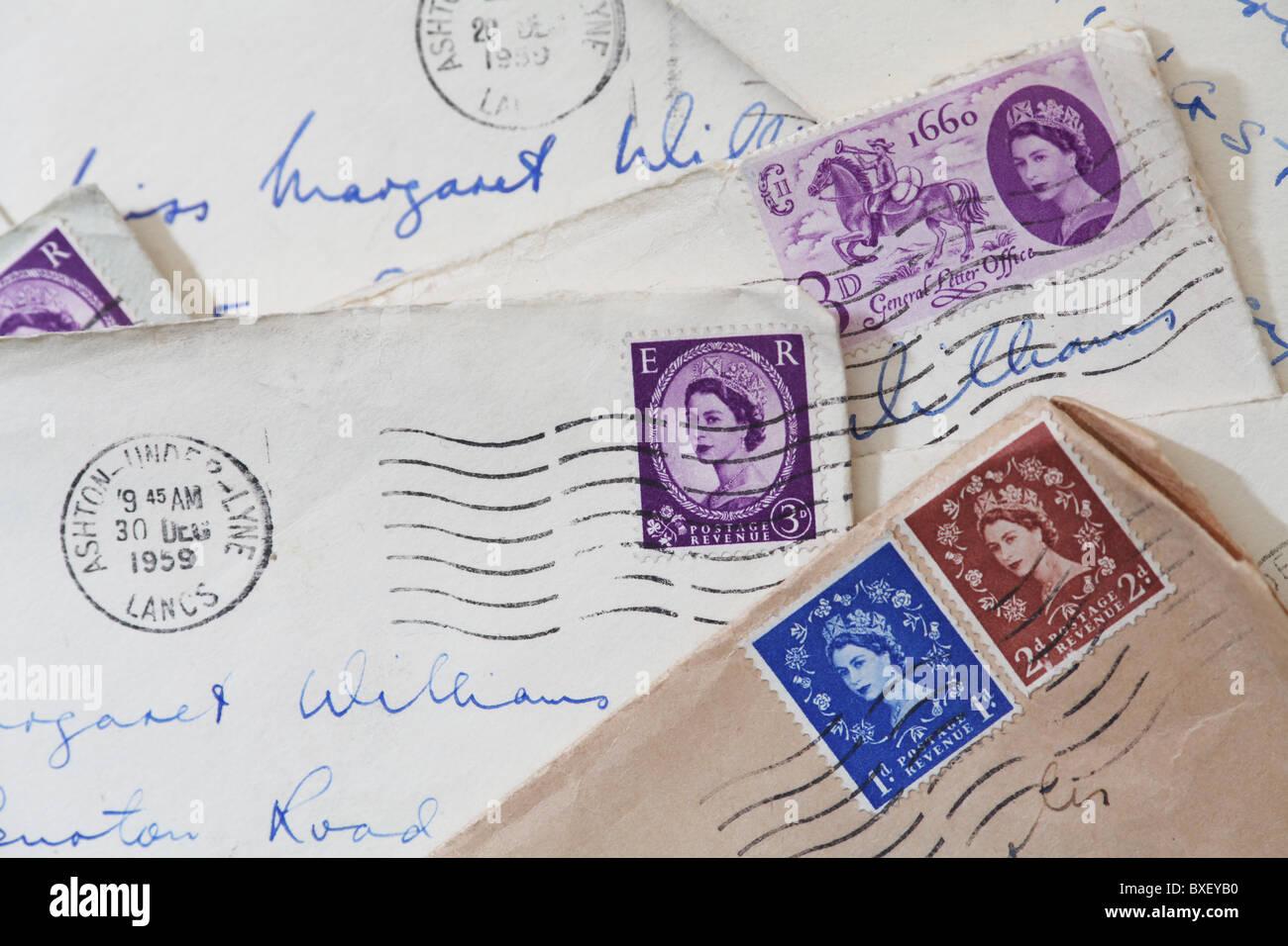 Queen Elizabeth II head on British Postal Stamps. - Stock Image