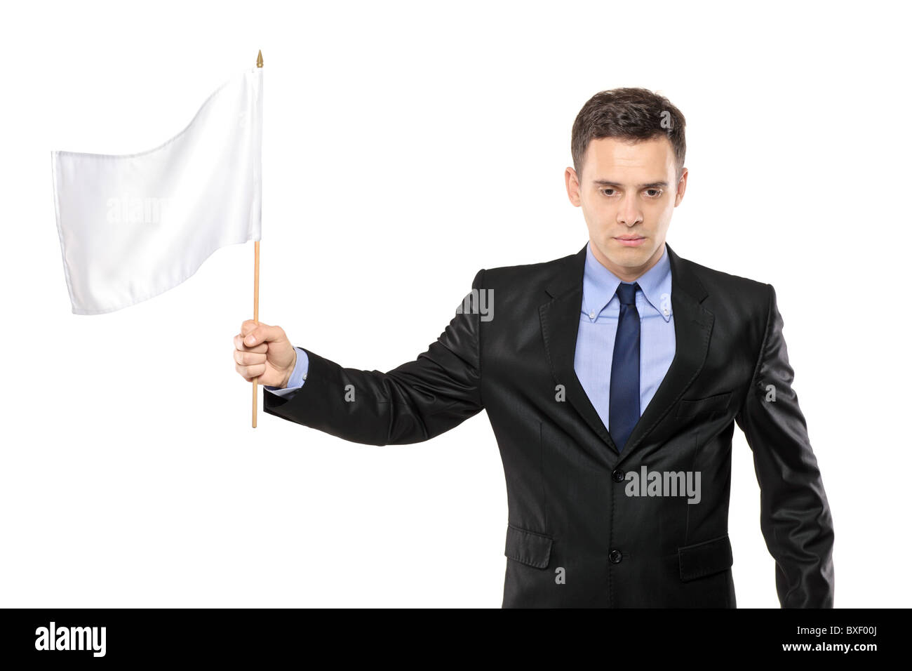 A sad man holding a white flag, gesturing defeat - Stock Image