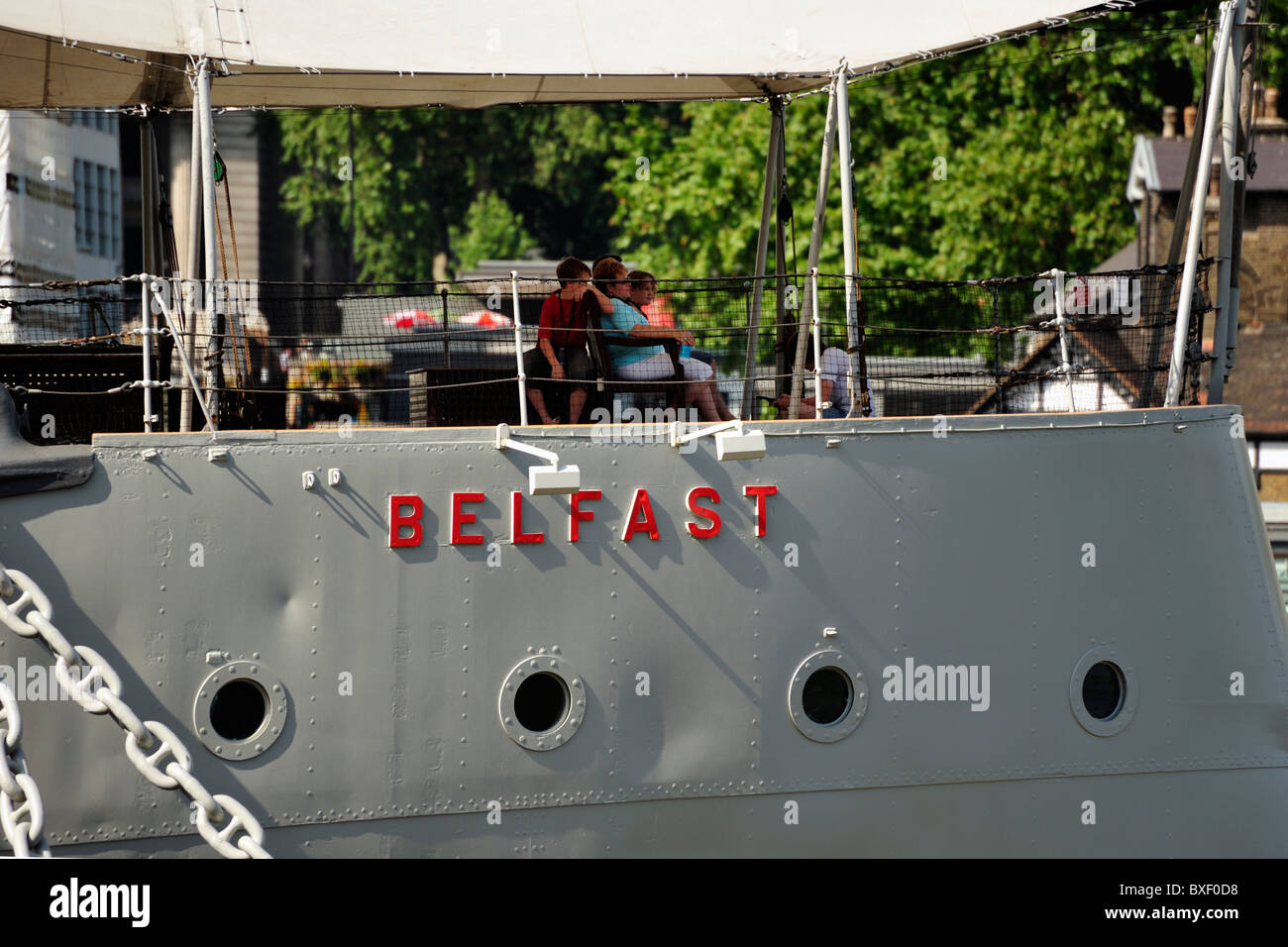 Close-up of HMS Belfast moored on the South Bank in London - Stock Image