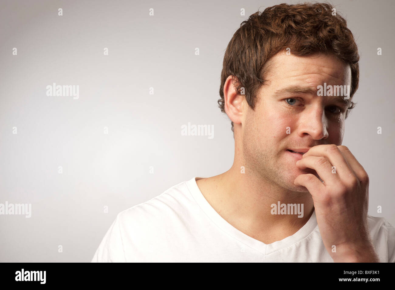 anxious nervous white caucasian male man biting his nails Stock ...