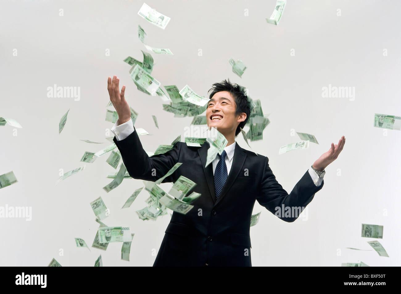 Money Raining Down On Businessman Stock Photo 33524648 Alamy