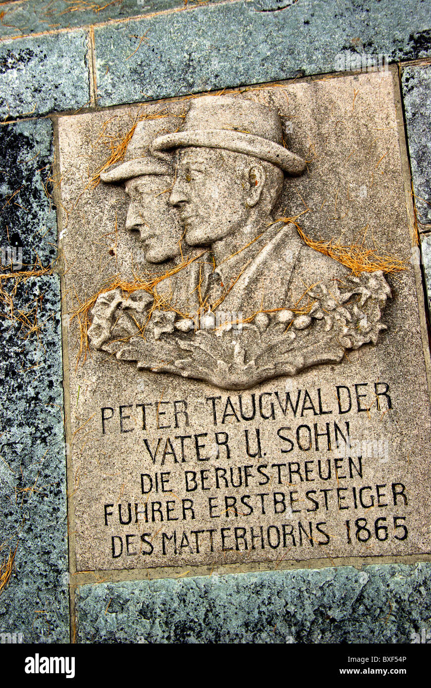 Gravestone of two father son mountain guides first successful ascentt on Matterhorn in Climbers cemetery Zermatt - Stock Image