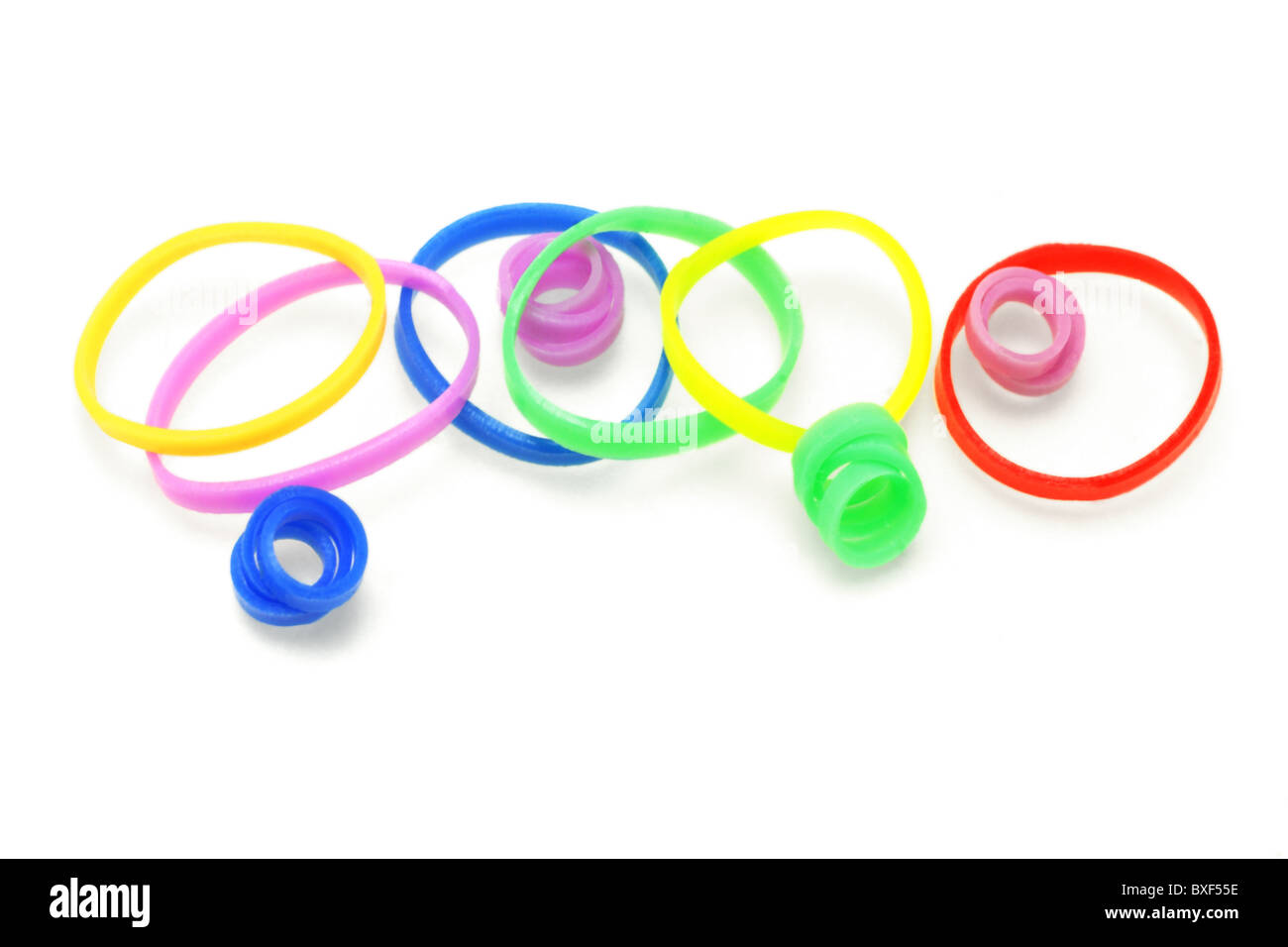 Colorful rubber bands arranged on white background - Stock Image
