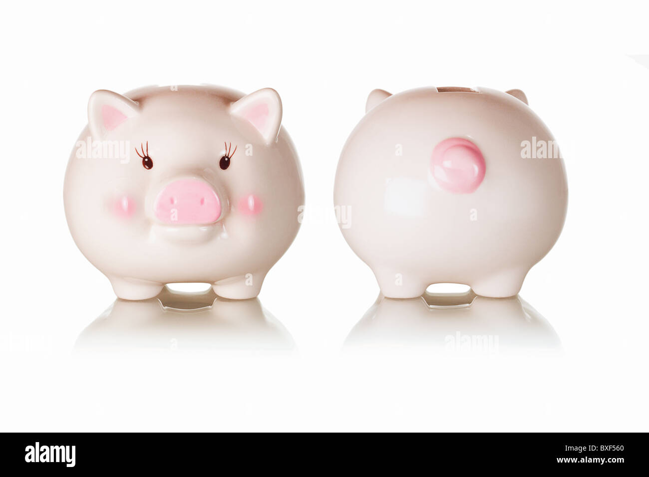 Frontal and rear views of piggybank with reflections on white background - Stock Image