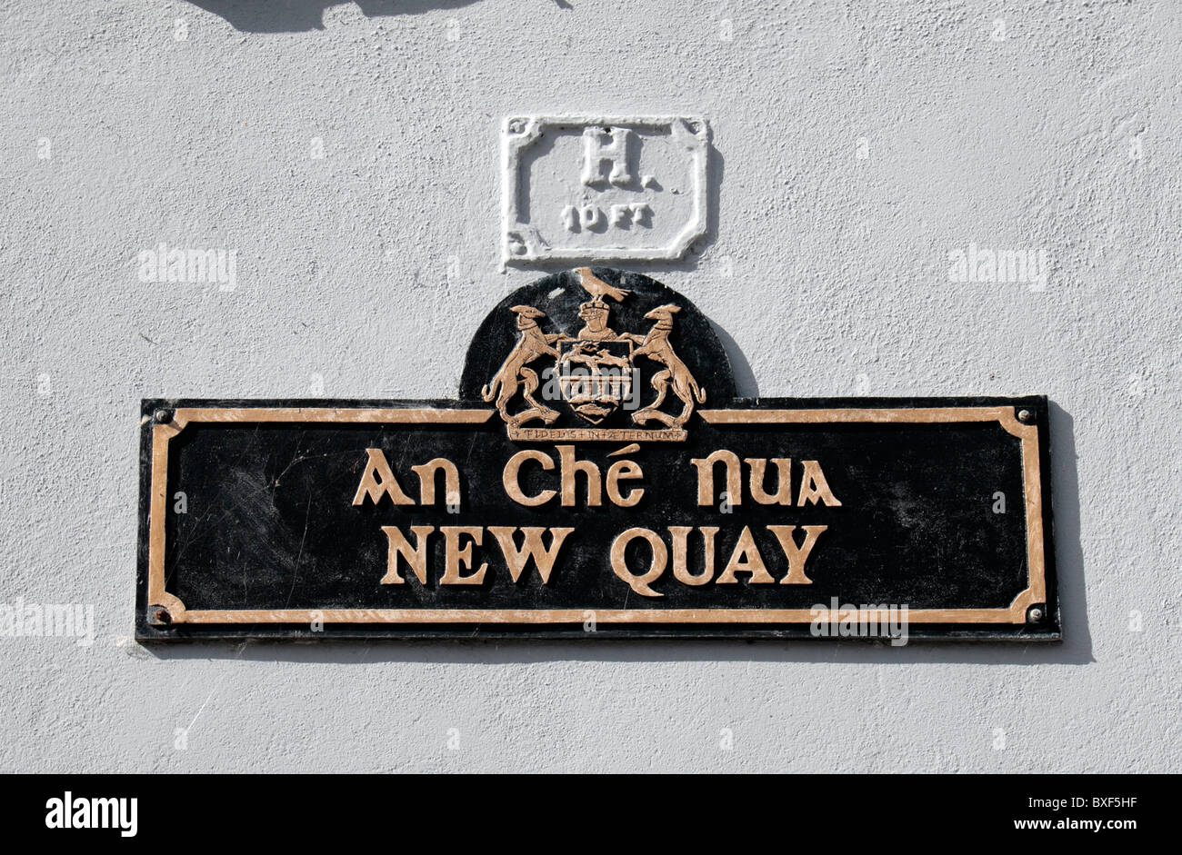 A traditional dual language road name sign in Clonmel, County Tipperary, Ireland (Eire). - Stock Image