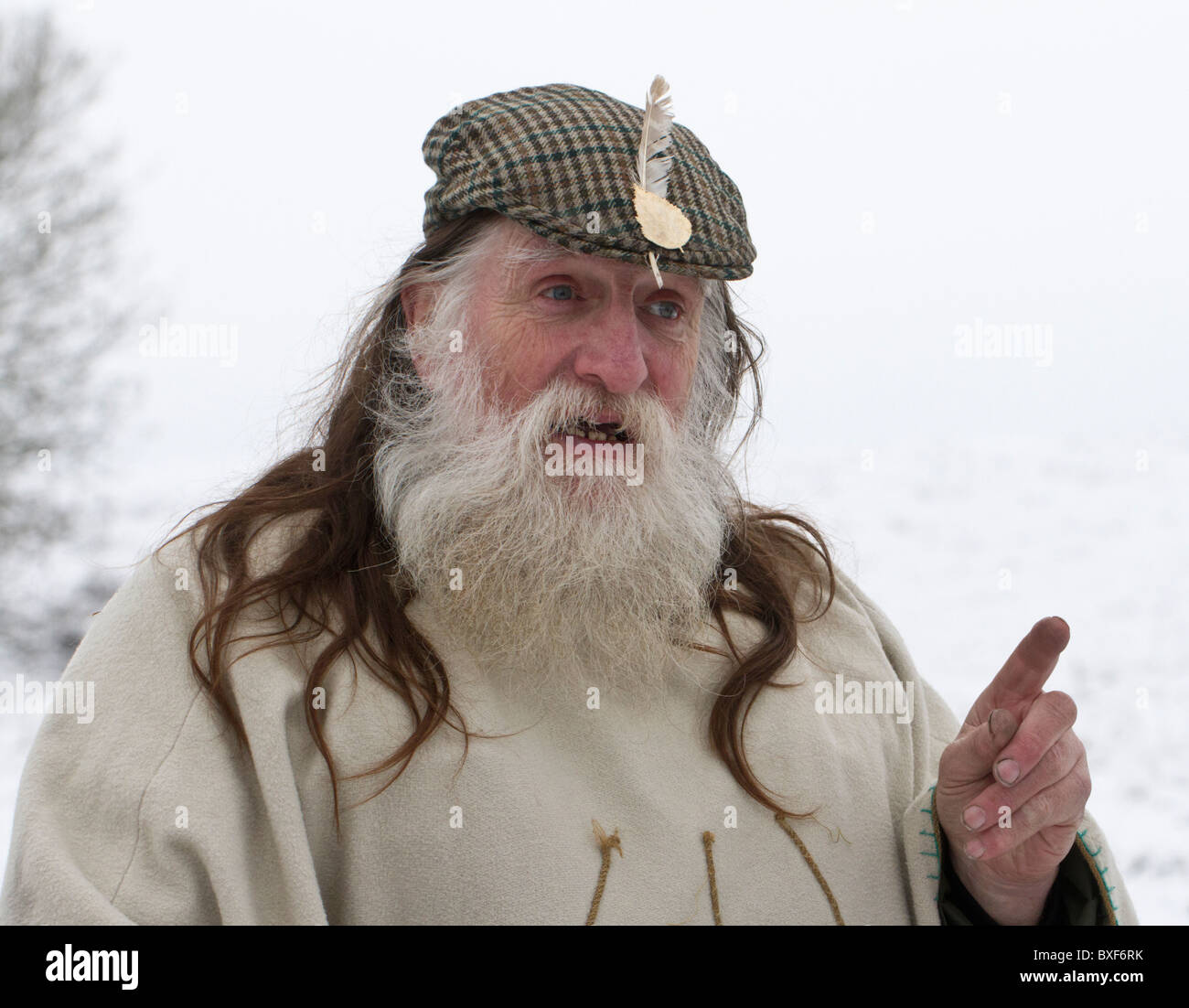 Arch-Druid of Avebury and Keeper of the Stones  Terry Dobney celebrating the Winter Solstice in the snow at Avebury, - Stock Image