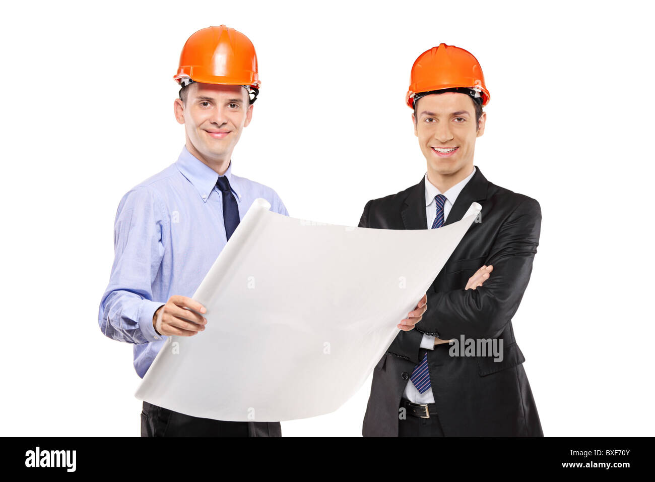 Foremen posing with blueprints - Stock Image