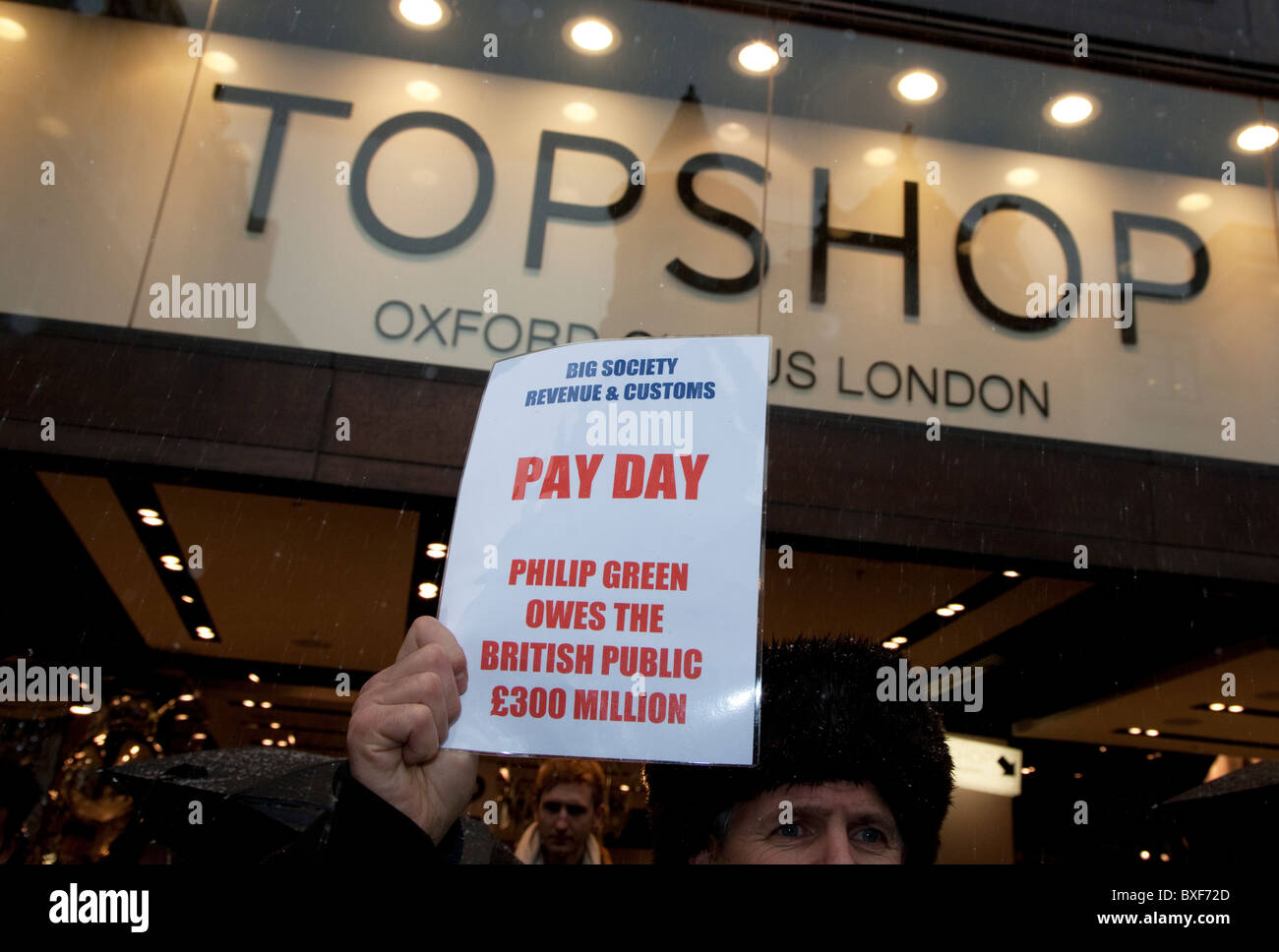 Protest against unpaid taxes at Topshop in Oxford Circus, London - Stock Image