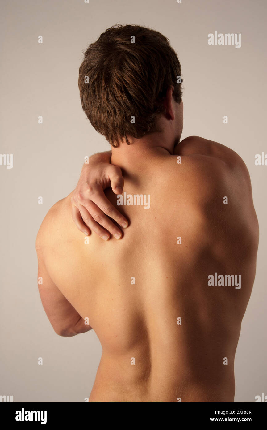 white caucasian male man suffering from back ache pain - Stock Image
